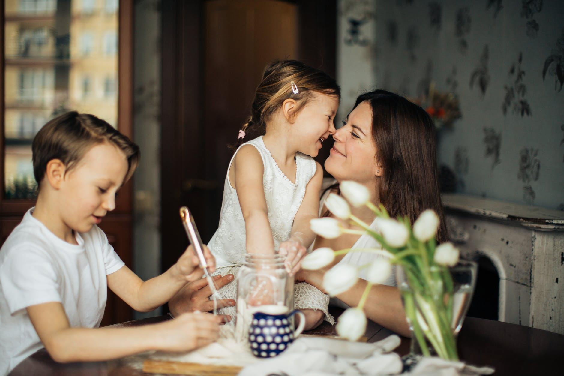 Mother and 2 children at breakfast table