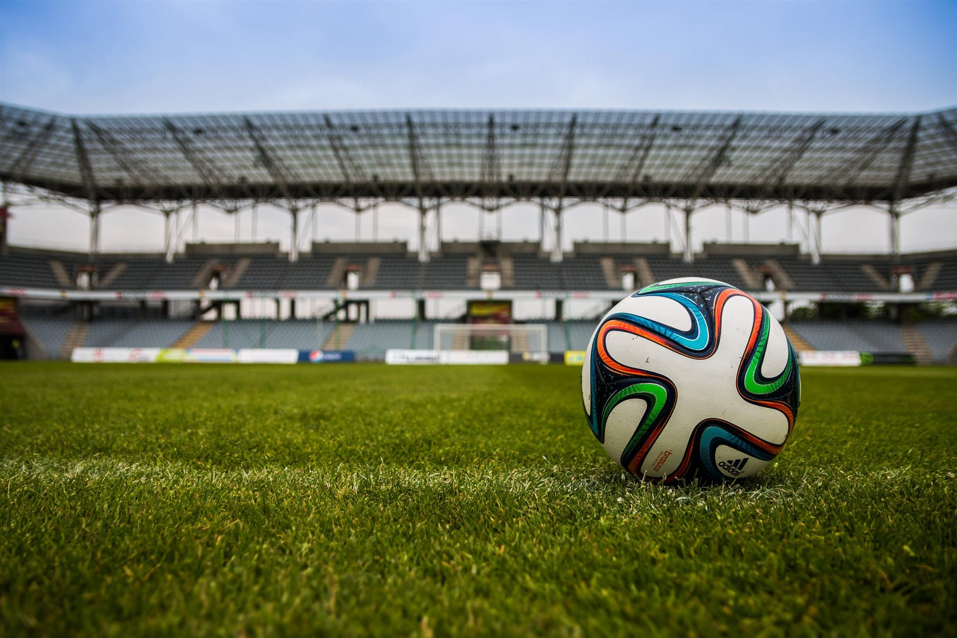 Soccer ball in field representing professional sports services